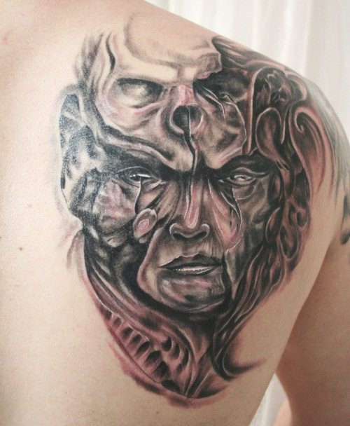 Face Skull Biomechanic Tattoo
