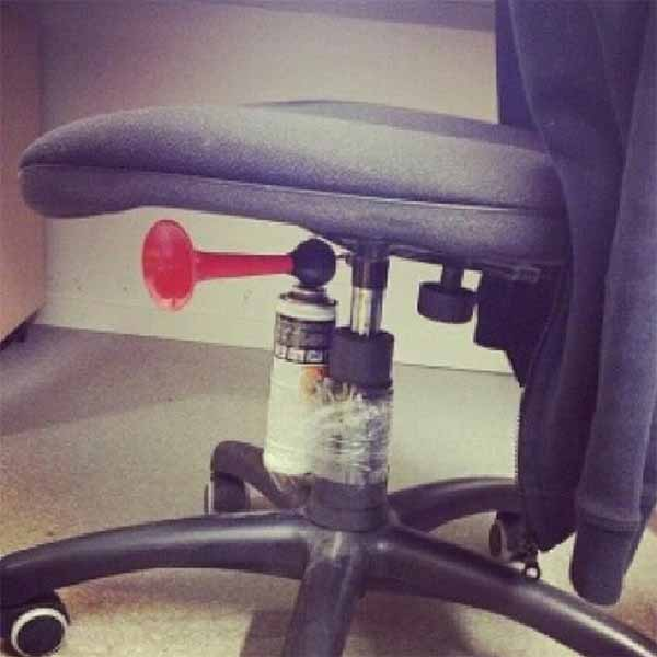 Tape an airhorn under a desk chair